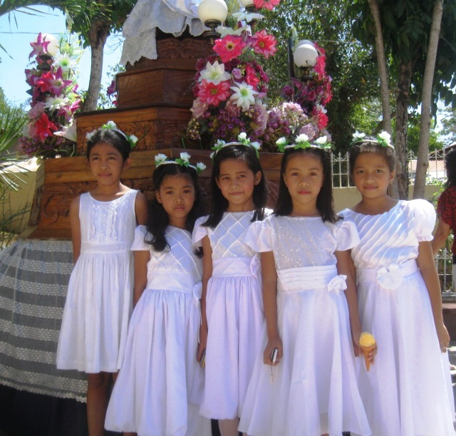 Filipina girls dressed in Sunday's finest for Easter Sunday