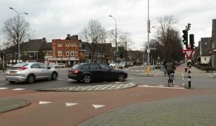 The Dutch Intersection with the white-checkered refuge island and maroon colored, segregated bike lanes